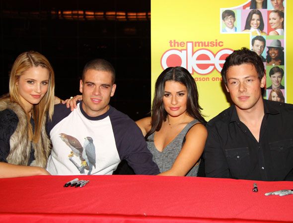 At the <i>Glee: The Music</i> CD signing, stars Dianna Agron, Mark Salling, Lea Michele, and Monteith smile for the cameras.<br />(© Tristan Fuge)