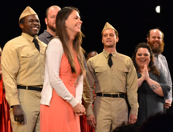 As her appreciative cast members look on, Sutton Foster takes her bow.<br />(© David Gordon)