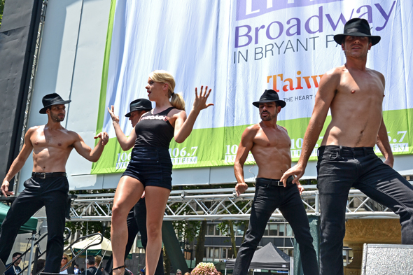 "Anne Horak and the buff men of <i>Chicago</i> sing ""Roxie.""<br />(© David Gordon)"