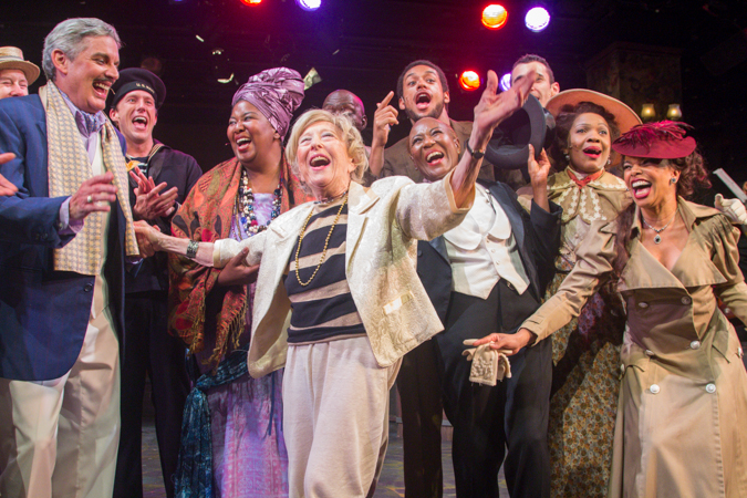 Cast members celebrate with composer/lyricist Mildred Kayden.<br />(© Seth Walters)