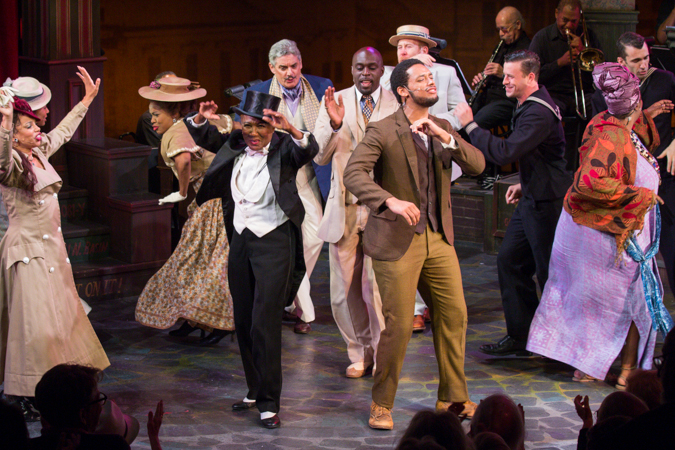 Cast members rejoice on stage.<br />(© Seth Walters)