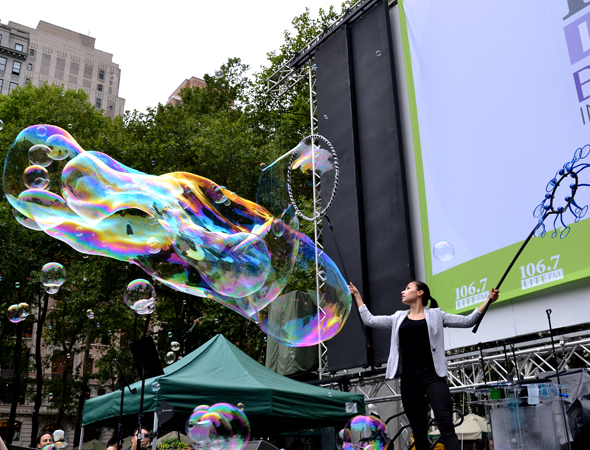 Melody Yang of <i>The Gazillion Bubble Show</i> thrills the audience in Bryant Park.<br />(© David Gordon)