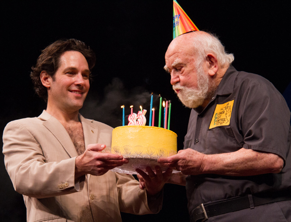 As Paul Rudd looks on, Ed Asner blows out the candles on the cake for his 83rd birthday on stage at Broadway's <i>Grace</i>.<br />(© Tristan Fuge)