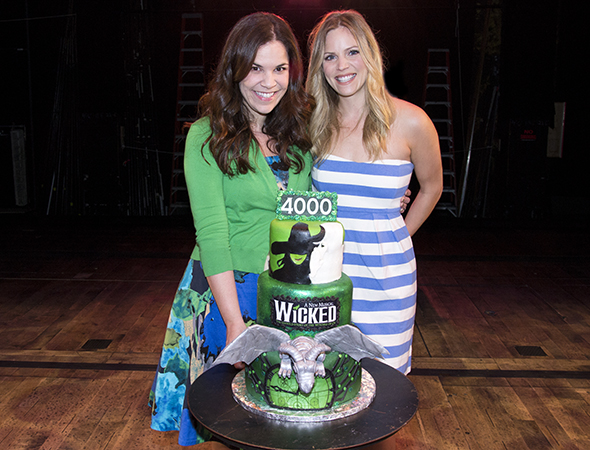 Lindsay Mendez and Katie Rose Clarke show off <i>Wicked</i>'s cake celebrating the show's 4000th performance.<br />(© David Gordon)