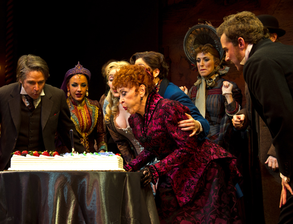 Chita Rivera and the cast of <i>The Mystery of Edwin Drood</i> blow out candles to celebrate the legendary actress' 80th birthday.<br />(© David Gordon)