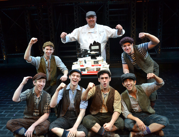 The <i>Newsies</i> newsboys are joined by <i>Cake Boss</i> chef Mauro Castano to present the show's beautiful one-year-anniversary cake.<br />(© David Gordon)
