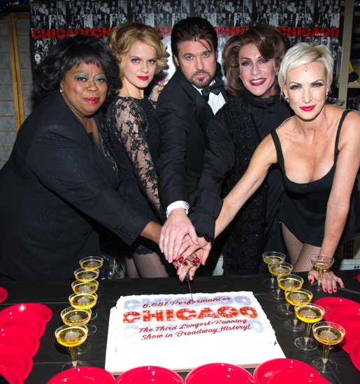 Carol Woods, Amy Spanger, Billy Ray Cyrus, R. Lowe, and Amra-Faye Wright ring in <i>Chicago</i>'s landmark 6,681st performance with a celebratory sheet cake.<br />(© David Gordon)