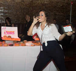Outstanding Ensemble Award winner Gerianne Pérez (<I>Volleygirls</I>) enjoys a much-deserved treat compliments of NYMF sponsor Dunkin' Donuts.