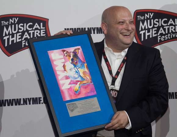 Isaac Hurwitz accepts a special gift recognizing his decade of service as executive director and producer of the New York Musical Theatre Festival. <br />(© Seth Walters)