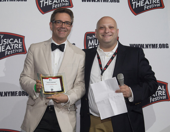 Joe Slabe (book/music/lyrics) of <I>Crossing Swords</I> accepts the Excellence in Book Award and Theater for the American Musical Prize from NYMF Executive Director Isaac Hurwitz.<br />(© Seth Walters)