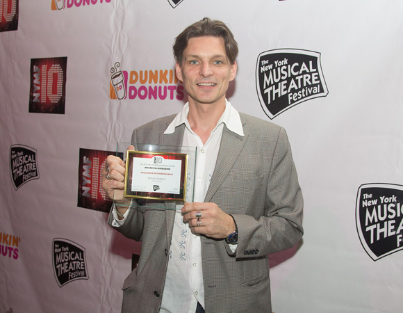Jonathan Stahl (associate director/dance captain) accepts the Excellence in Choreography award on behalf of Richard Stafford (director/choreographer) for <I>Castle Walk</I>.<br />(© Seth Walters)