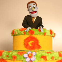<i>Avenue Q</i>'s Rod tops the show's birthday cake from early in its run.