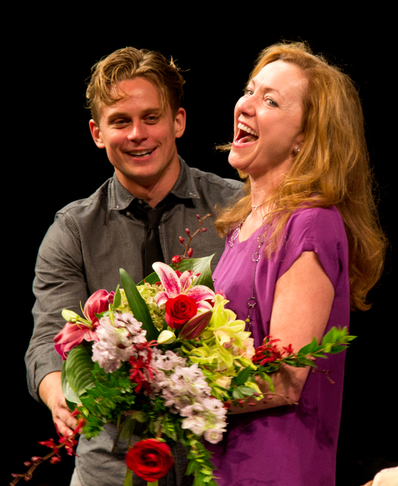 Billy Magnussen presents an ecstatic Julie White with a beautiful bouquet of flowers.