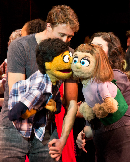 Princeton (Darren Bluestone) and Kate Monster (Veronica J. Kuehn) share a kiss to mark the occasio