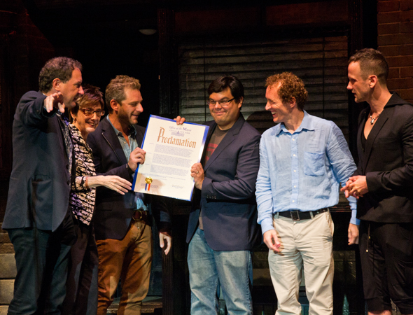 "Producers Kevin McCollum and Robyn Goodman, writers Jeff Marx and Robert Lopez, producer Jeffrey Seller, and book writer Jeff Whitty show off a proclamation from New York City marking July 31 ""<i>Avenue Q</i> Day."" <br />(© David Gordon)"