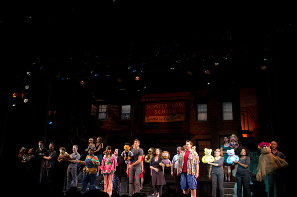 <i>Avenue Q</i> alumni join the current cast on stage to sing the final number, <i>For Now</i>.<br />(© David Gordon)