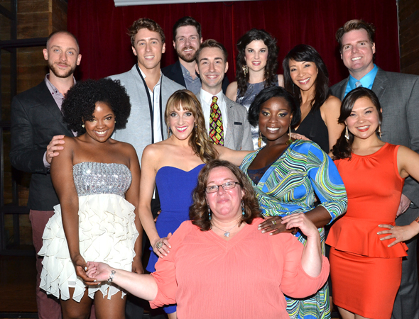 The current company of <i>Avenue Q</i> and stage manger Christine M. Daly smile for the cameras.<br />(© David Gordon)
