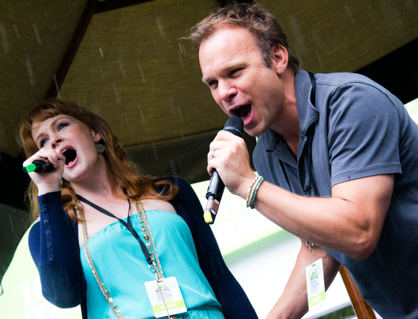 Even with rain pouring down, Kate Baldwin and Norbert Leo Butz are troupers.<br />(© David Gordon)