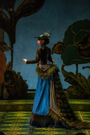 Nikka Graff Lanzarone struts her feathers as Ms. Peacock.<br />(© Liz Lauren)