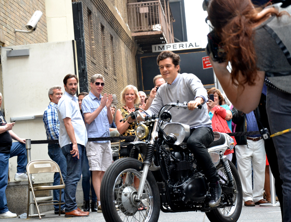 Production star Orlando Bloom arrives sensibly — on the back of a motorcycle (which he will ride in the show).<br />(© David Gordon)