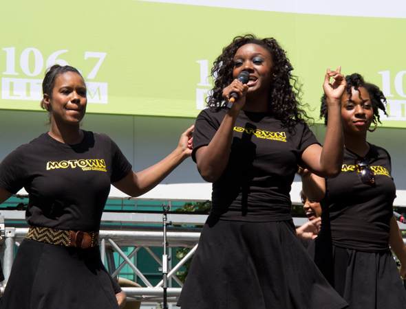 "Saycon Sengbloh and <i>Motown</i> ladies Rebecca E. Covington and Crystal Joy lead the audience in ""Dancing in the Street.""<br />(© David Gordon)"