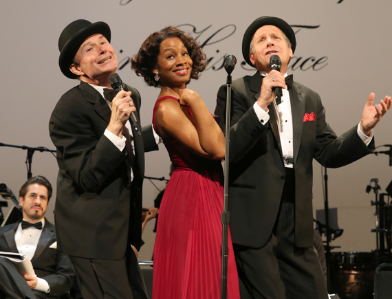 Rich lady and her pet artists: Anika Noni Rose as Mrs. Mister, with Henry Stram as Dauber and Martin Moran as Yasha in <i>The Cradle Will Rock</i>.