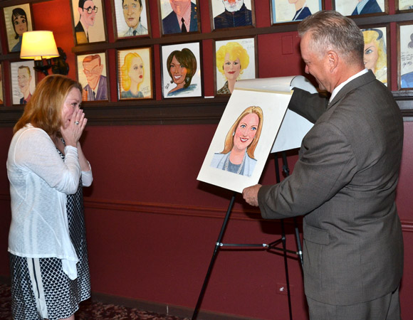 Kristine Nielsen shows her surprise as she sees her new caricature for the first time.