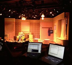 A photo from a tech rehearsal for The Hatmaker's Wife.