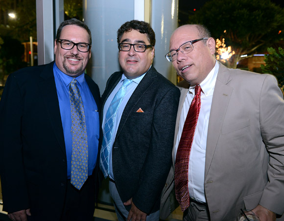 Andy Perez (center) flanked by Peter Goldman (L) and Tim Choy (R) of Davidson & Choy Publicity.