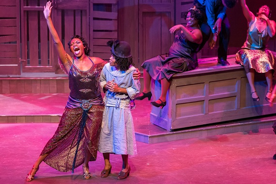 Adrienne Walker, Trisha Jeffrey, and the company of <i>The Color Purple</i>.