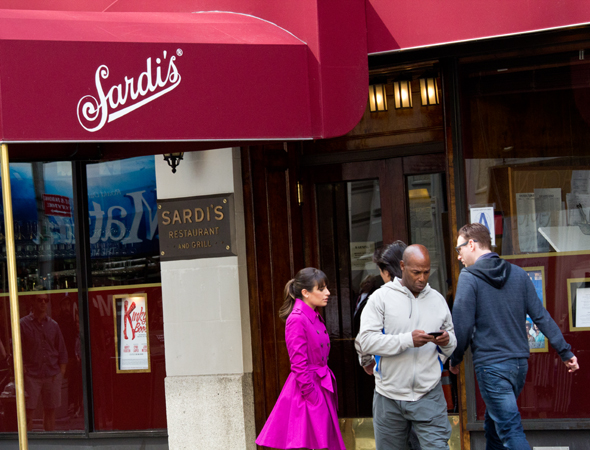 Michele strolls near Sardi's.<br />(© David Gordon)