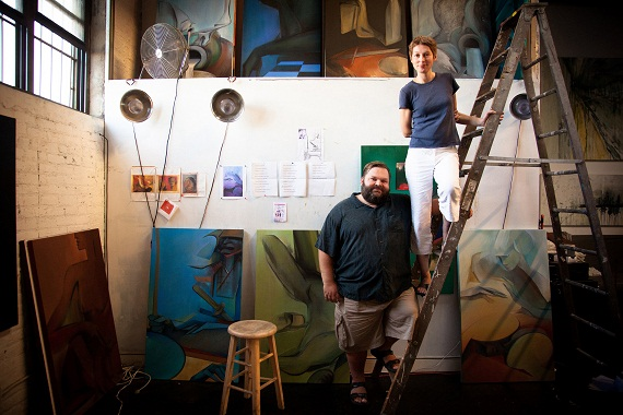 Mike Daisey and artist Larissa Tokmakova in her studio with select oil paintings featured in <i>All the Faces of the Moon</i>.