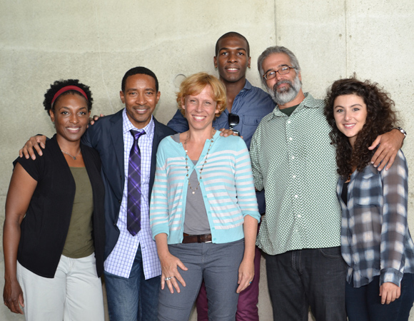 The cast of <i>Love in Afghanistan</i> with playwright Charles Randolph-Wright (second from left) and director Lucie Tiberghien (third from left). <br />(© Arena Stage)