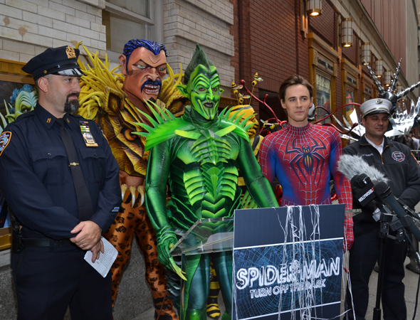 Reeve Carney joins <i>Spider-Man: Turn Off the Dark </i> villains and members of the NYPD to present Halloween safety tips in 2012.<br />(© David Gordon)