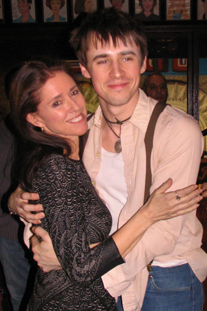 At a pre-opening party, Reeve Carney snuggles up to the show's original director, Julie Taymor.<br />(© David Gordon)