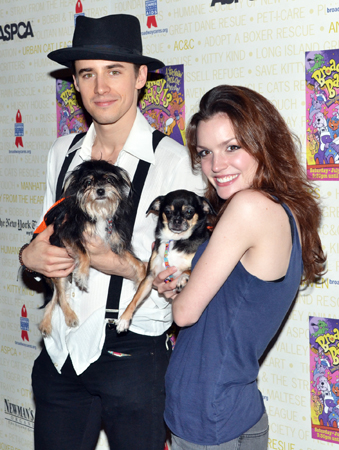 Reeve Carney and Jennifer Damiano play with some adorable puppies at Broadway Barks in 2011.<br />(© David Gordon)