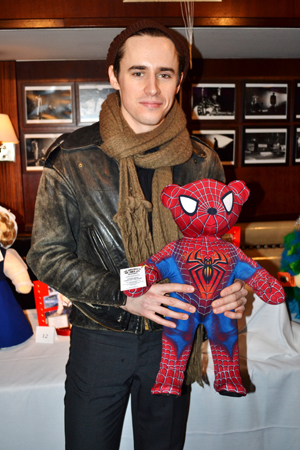 Reeve Carney shows off the <i>Spider-Man: Turn Off the Dark</i> bear at the 2011 Broadway Bears.<br />(© David Gordon)