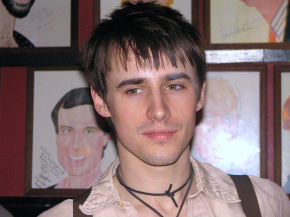 A baby-faced Reeve Carney smiles for the camera in 2011.<br />(© David Gordon)