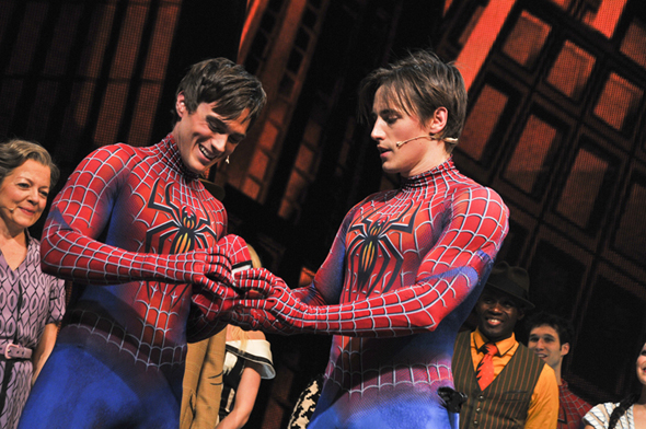 The ceremonial passing of the mask.<br />(© Jenny Anderson/SPIDER-MAN Turn Off The Dark)