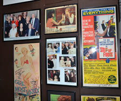 The walls of McKay's apartment are decorated with film and Broadway memorabilia.