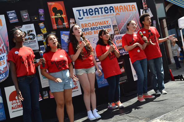 The tweens of TADA! Youth Theater sing their hearts out.<br />(© David Gordon)