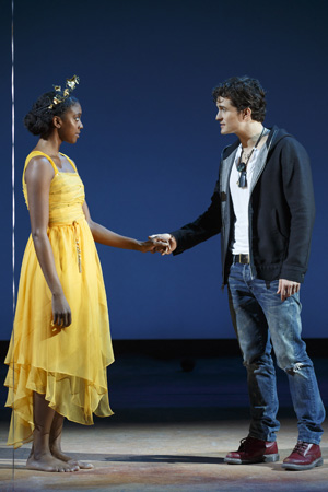 Juliet (Condola Rashad) and Romeo (Orlando Bloom) catch eyes at a rocking party and fall instantly in love. <br />(© Carol Rosegg)