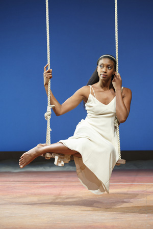 Condola Rashad's Juliet swings on a swing as she contemplates her love. <br />(© Carol Rosegg)