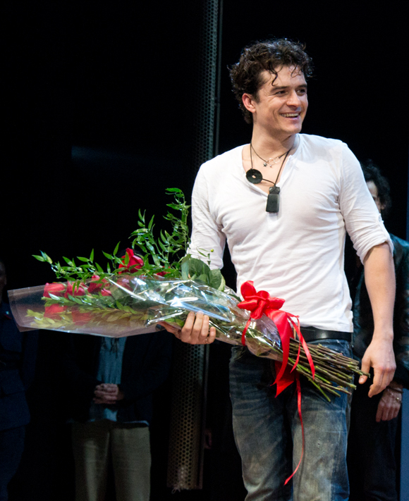 Orlando Bloom is thrilled as he receives a bouquet of flowers during his curtain call.