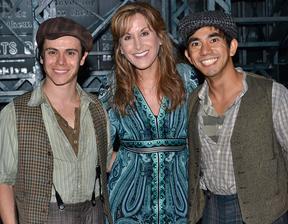 Tommy Martinez, Jodi Benson, and Aaron J. Albano onstage at <i>Newsies</i>.