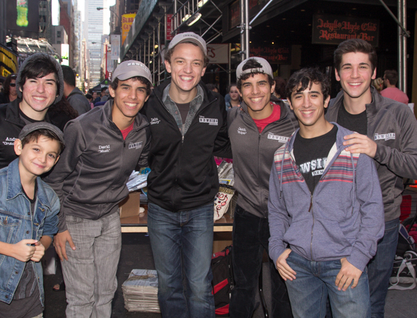 Cast members from <i>Newsies</i> carrying the banner for the Broadway Flea Market.<br />(© Seth Walters)
