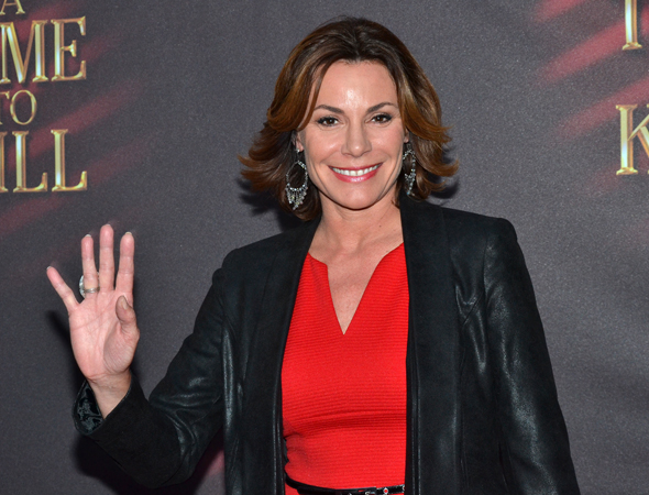 Real Housewife Countess LuAnn de Lesseps waves to the cameras.<br />(© David Gordon)